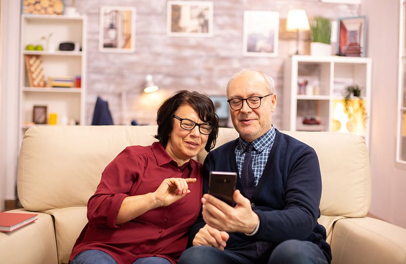 beautiful-elderly-couple-taking-a-selfie-while-8P28C4N