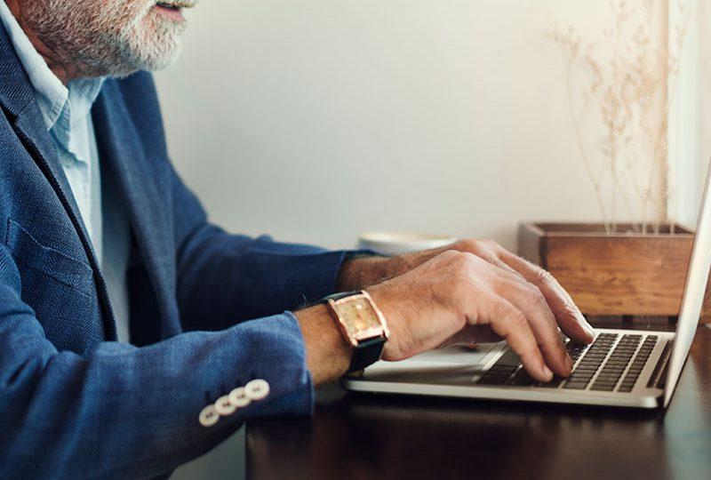 elderly-man-is-using-computer-laptop-P8V8RUF